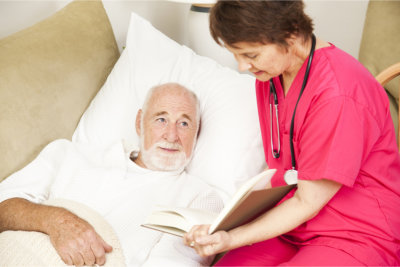 caregiver writing elderly man's information