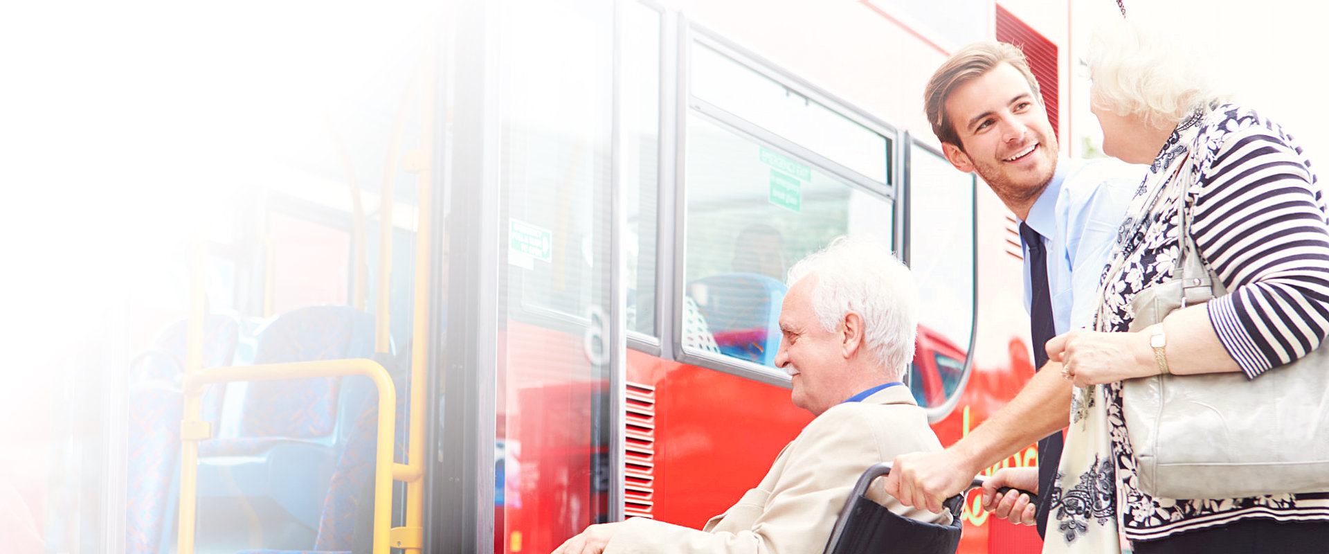elderly couple getting inside the bus